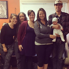 Marli Ivers, midwife stands with stephanie libs, local chiropractor, her partner and the birth team