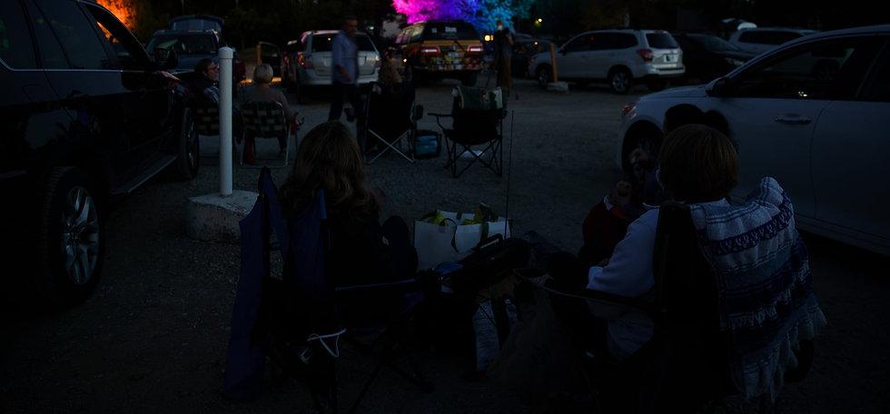 People watch an outdoor film screening