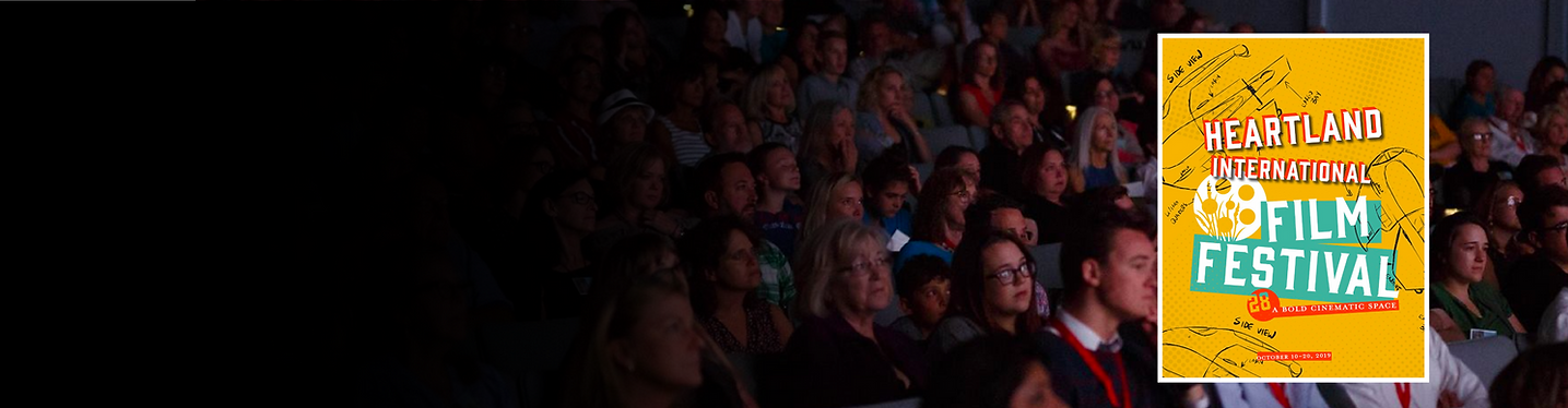 An audience watches a film