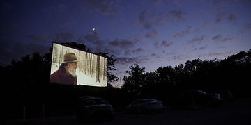 Film plays at a drive-in theater