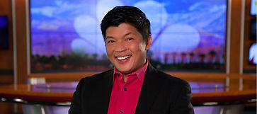 Newscaster smiles at camera
