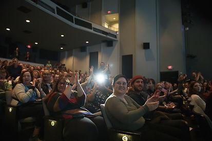 An audience applauds