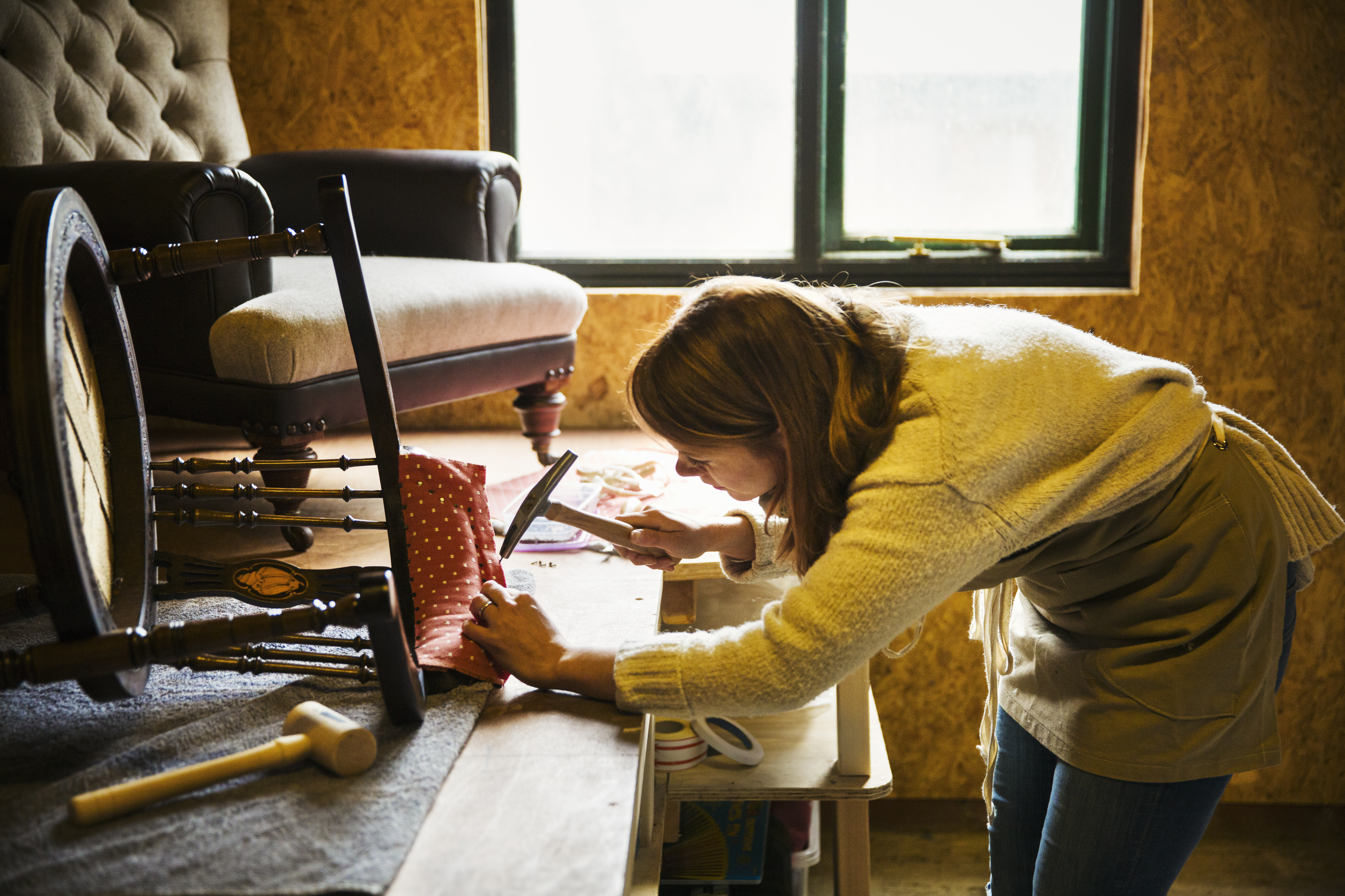 upholstery-workshop-a-woman-hammering-fa