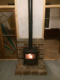 Wood burning stove on new hearth
