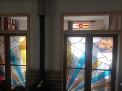 Stain glass doors lead to extension