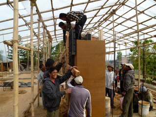 Rammed earth and bamboo house in Nepal stand through earthquake