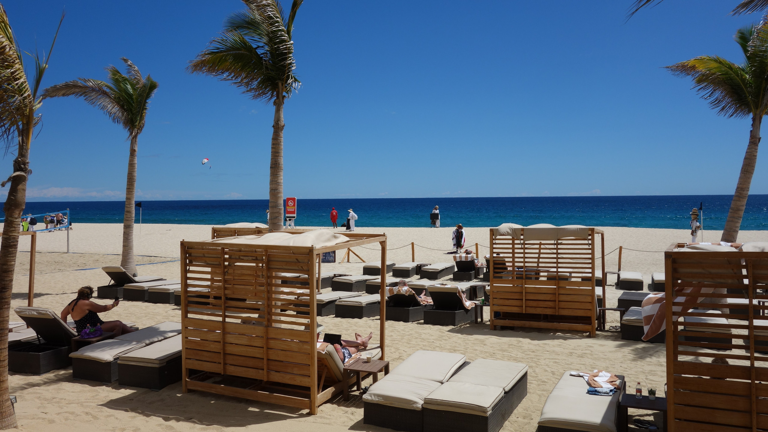 The beach with lounge chairs and Bali beds. Notice the rope to keep the beach vendors from harassing the resort guests?