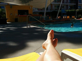 My happy place is by the pool in front of the bar.