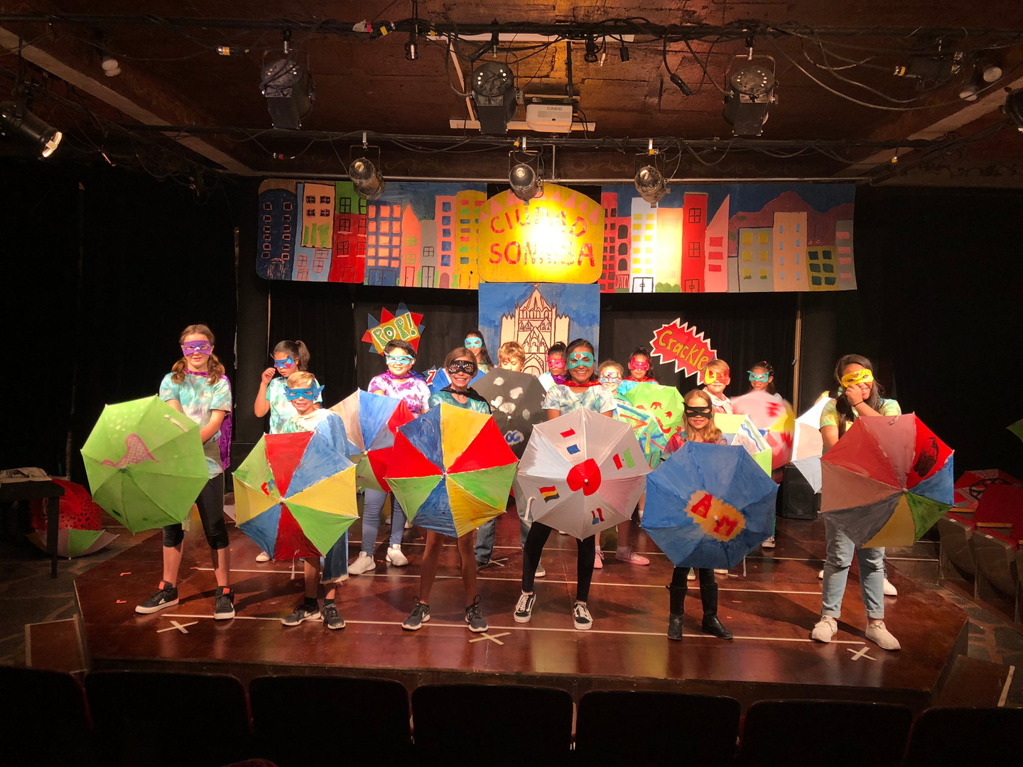Musical number with umbrellas