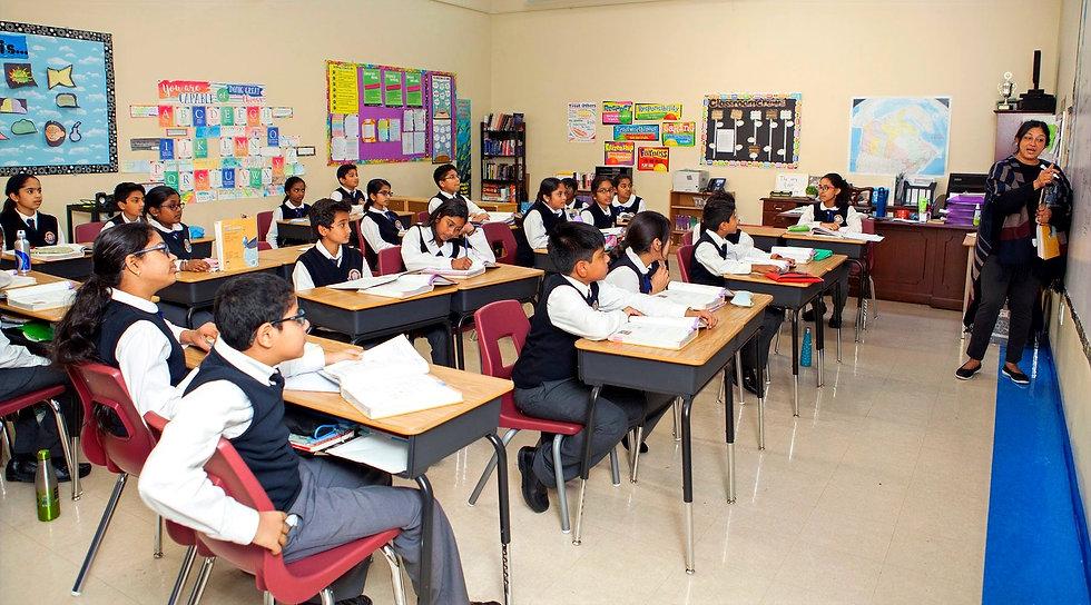 Sathya Sai school students in class with teacher