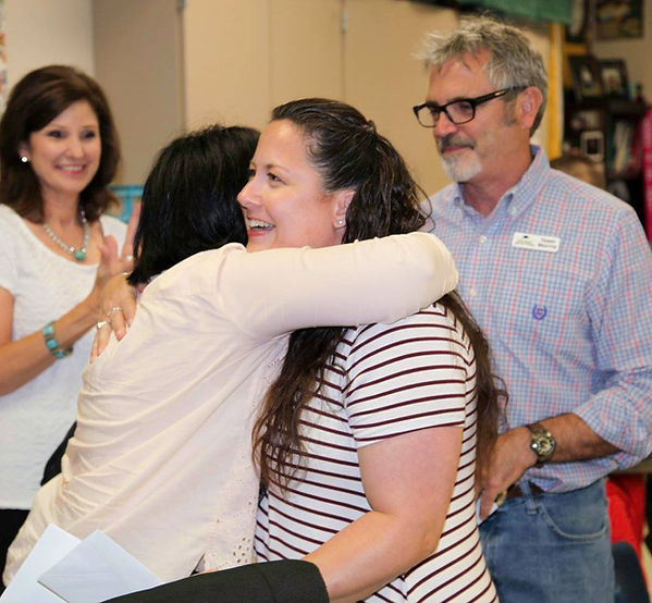 ACCEPTING GRANT WITH HUG.jpg
