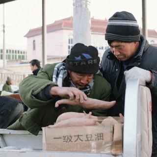 Farmers selling Sweet Potatoes