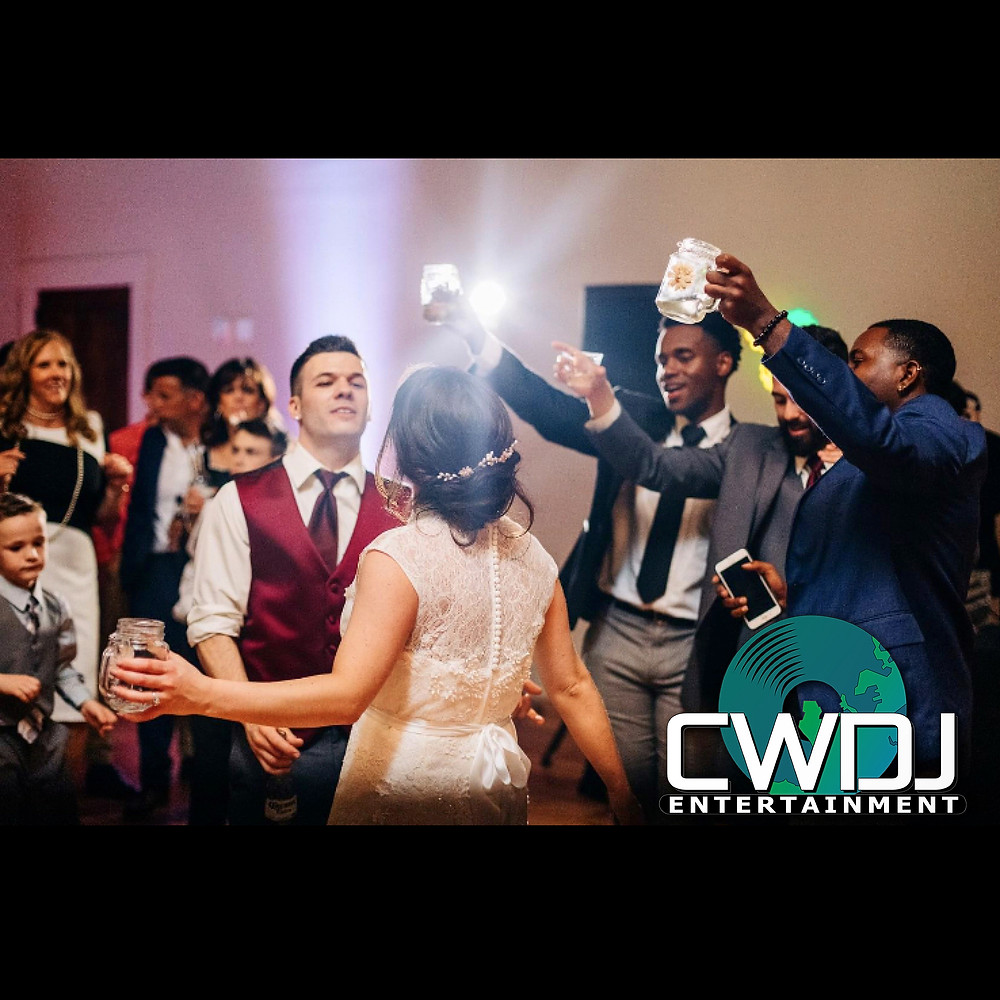 wedding dj and wedding photo booth in Raleigh NC. CWDJ Entertainment plays at Cross and Main Wedding Venue in Youngsville NC