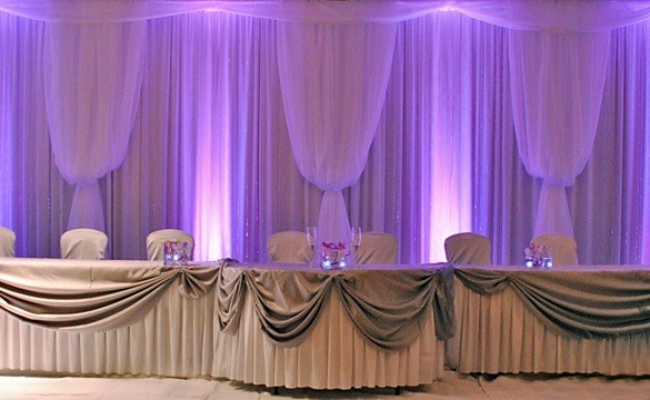 Purple lighting with white drapes