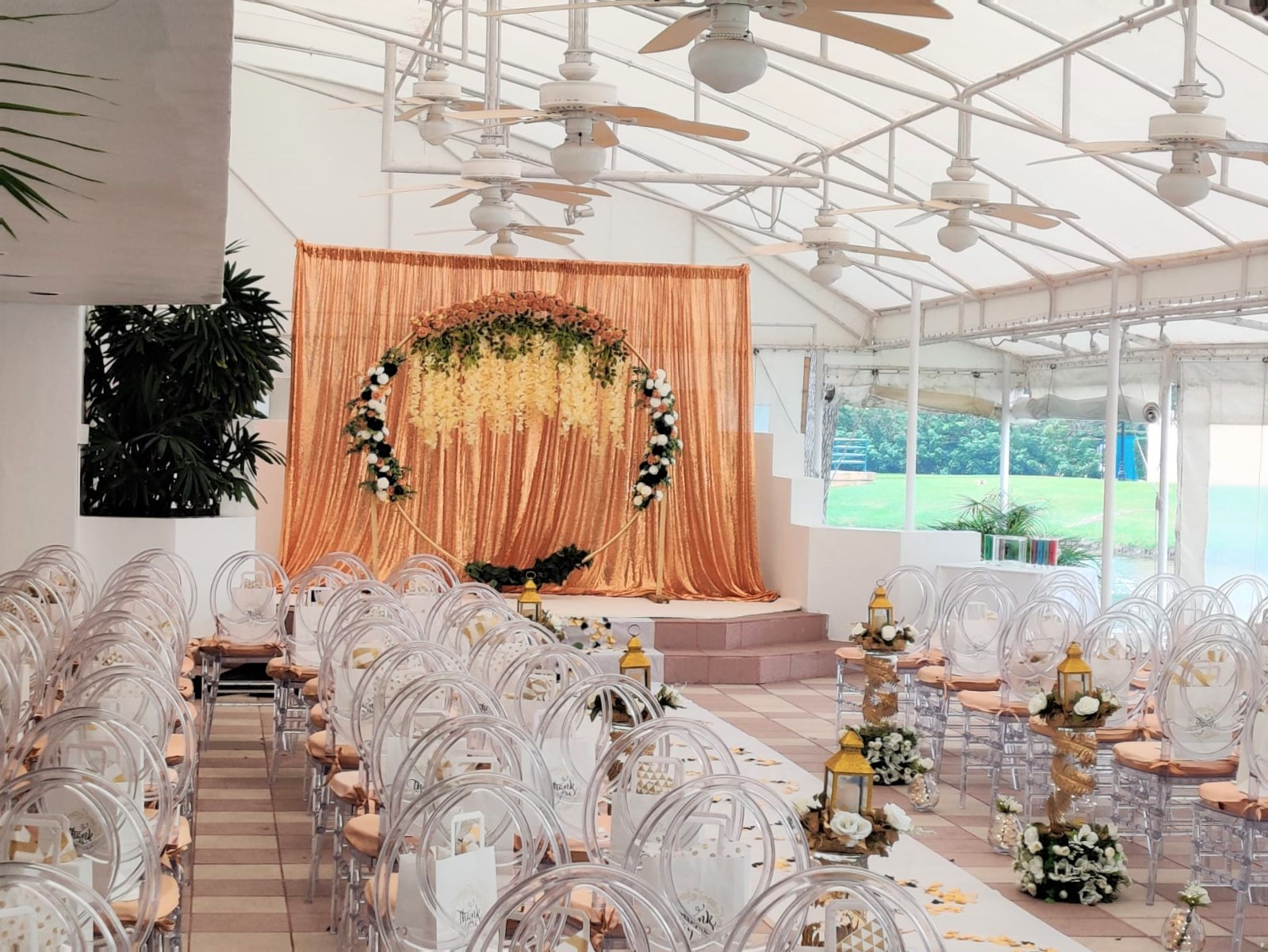 gold black and ivory backdrop and floral arch for Wedding stage