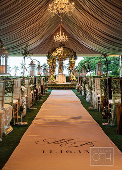 rustic natural decor, wood, flowers, greenery with lantern aisle markers
