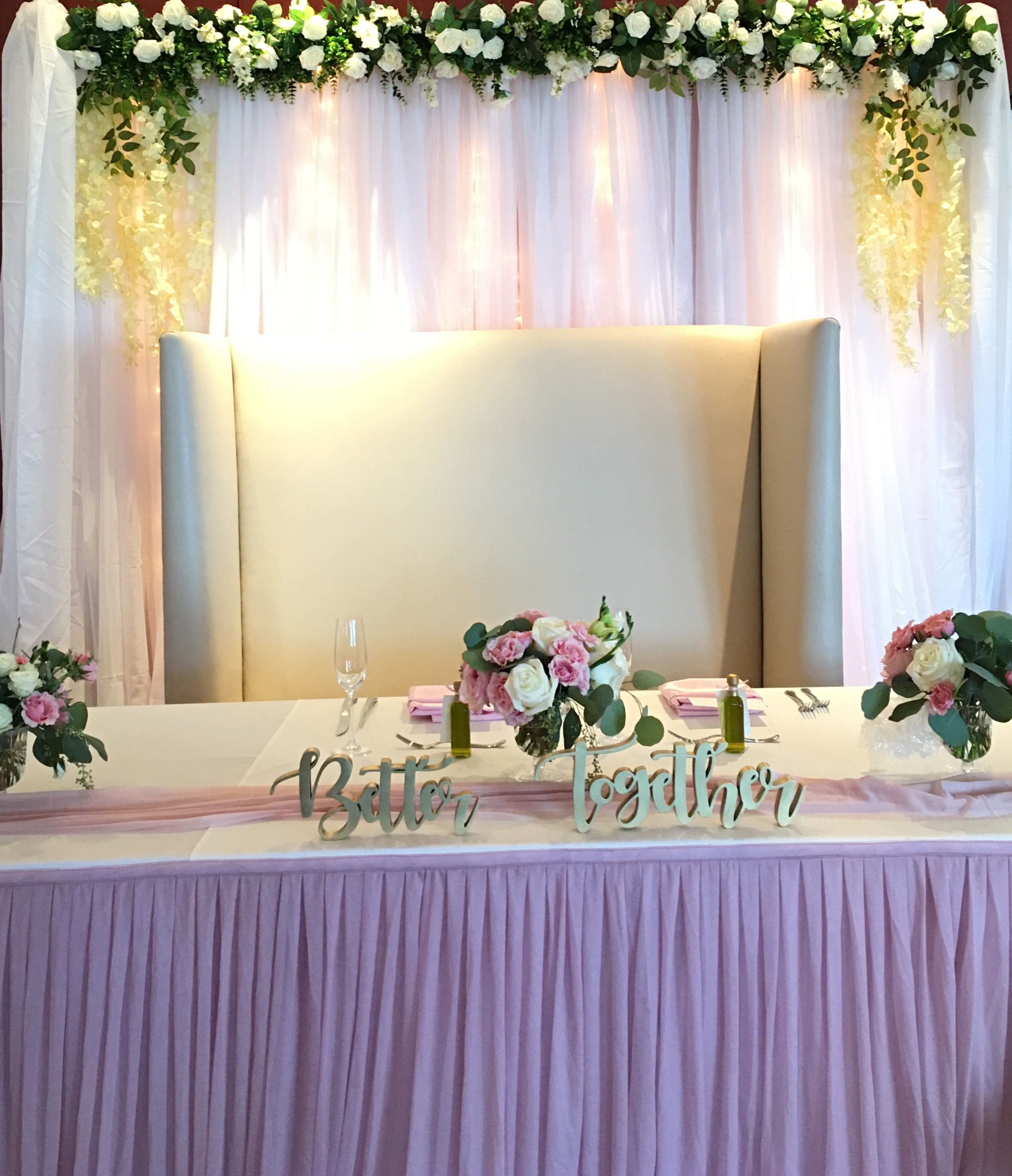 blush, pink head table with floral backd