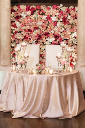 Sweetheart table with floral wall backdrop