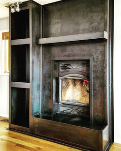 patinad steel fireplace
