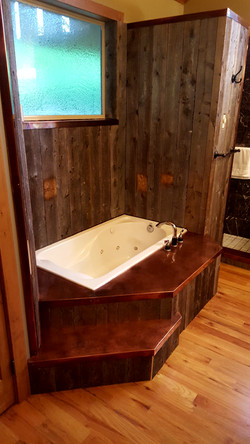 patinad copper bathtub surround