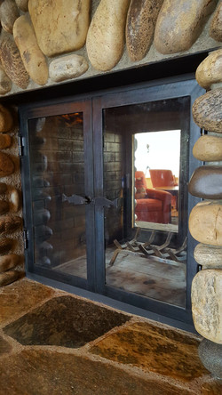 patinad steel fireplace doors