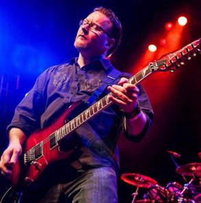 Dennis Grove red guitar.jpeg