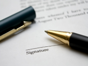 signing-deed-of-purchase.png