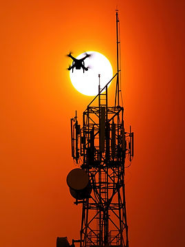 telecommunication tower and drone on sun