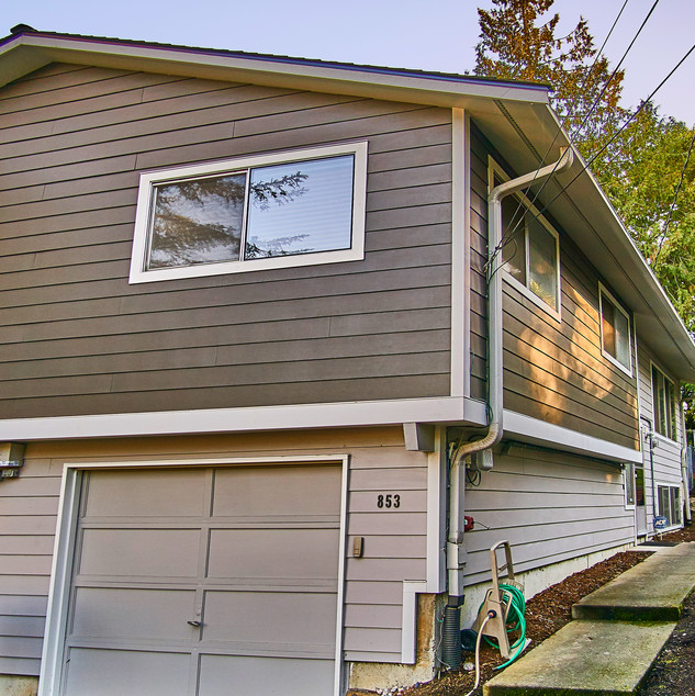 T1-11 siding replacement, new baked-on ColorPlus HardiePlank Lap Siding in Timber Bark and