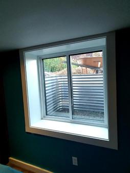 Flush built in header for egress window