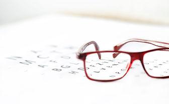 eye exam chart and reading glasses