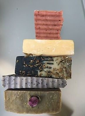 stack of five soaps different sizes