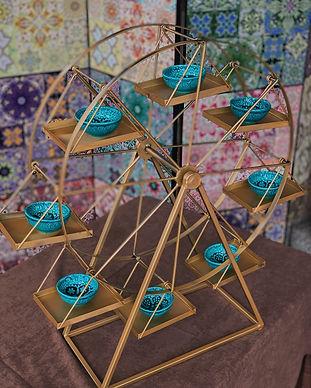 Buffet Riesenrad drehend Fingerfood Highlight gold Zirkus Thema Circus bestellen dekoration