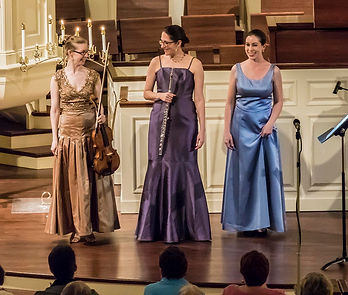 Trio Sirènes bowing at a performance at Second Presbyterian Church