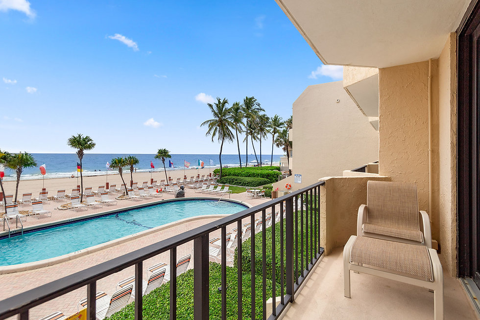 This is an oceanfront balcony overlooking the pool and beach at Costa del Sol in Lauderdale By The Sea, Florida.