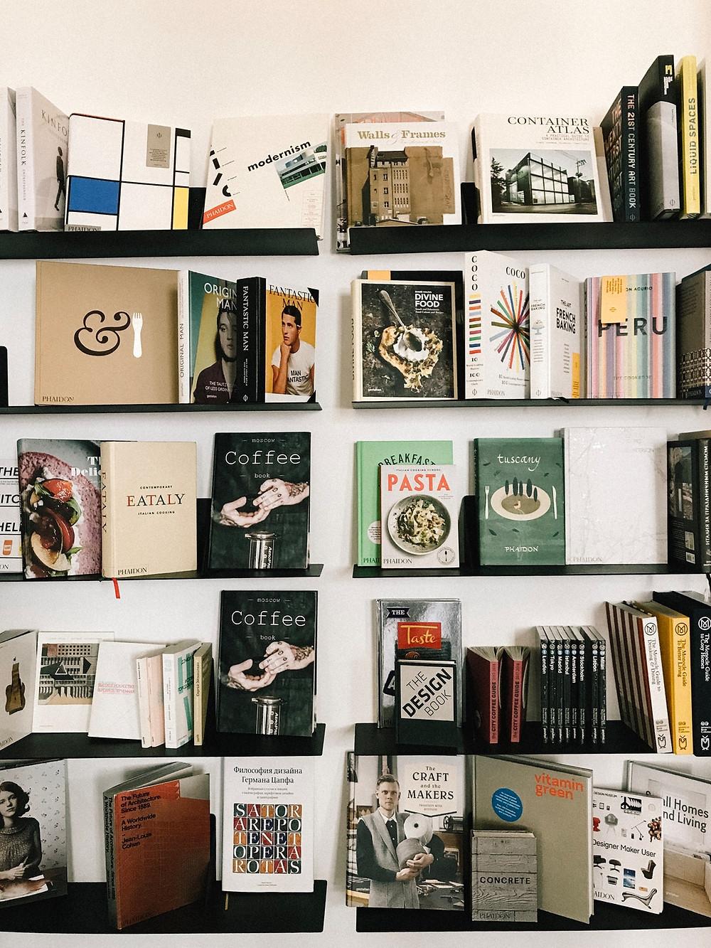 bookshelf with books and magazines
