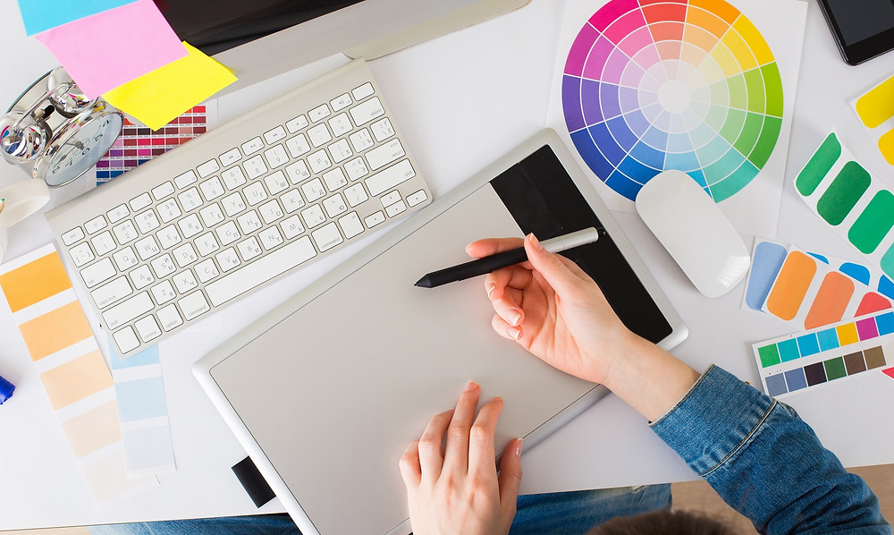 young graphic designer using graphics tablet to do her work
