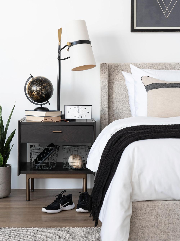 Teenage bedroom design with grey headboard and modern dark oak nightstand.