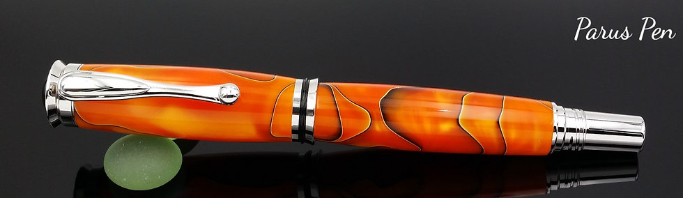 Handmade rollerball pen with rhodium finish and Persimmon Swirl acrylic clip view