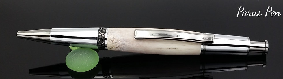 Handmade ballpoint pen with black titanium finish and deer antler clip view