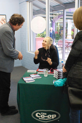 Signing copies of 'Beneath the Grace of Clouds' at The Co-op - Southern Cross University 2010