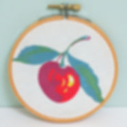 Handmade embroidery hoop swatch portrait with red cherry