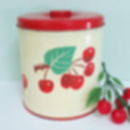 Vintage metal kitchen canister with red cherries