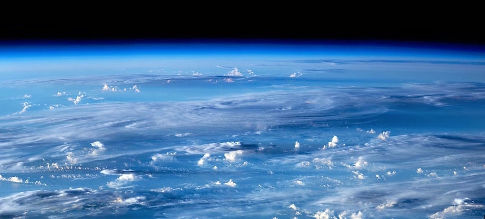 Earth Atmosphere with Clouds.jpg