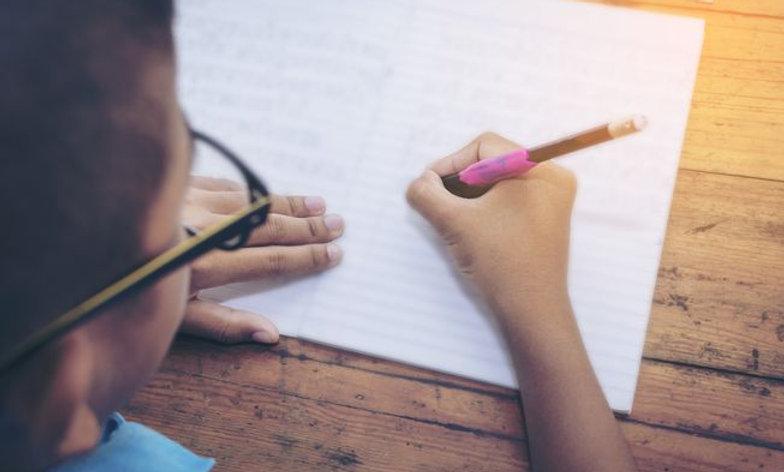 boy writing language arts advanced language lessons best online homeschool programs online classes 4th 5th grades virtual