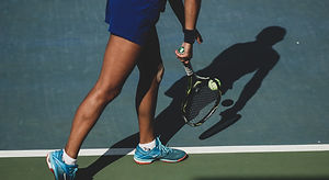 woman%20holding%20tennis%20ball%20and%20racket_edited.jpg