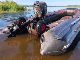 Inflatable boat launched into the river
