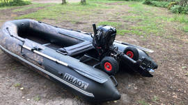 Inflatable boat with the motor and launch wheels