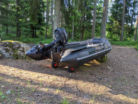Inflatable boat with motor on launch wheels