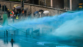 Hong Kong police are spraying protesters with blue-dye water cannons to mark them for arrest later